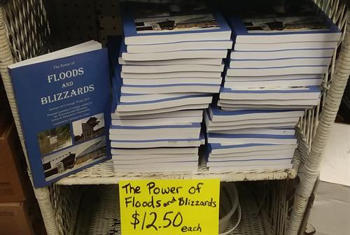 The Power of Floods and Blizzards books compiled by Christian M Fisher for $12.50 each.
