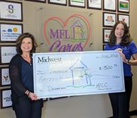Midwest Family Lending, an Urbandale-Based Mortgage Company, Donates $1500 through its MFLCares Program to the Indianola YMCA to Help Strengthen Community