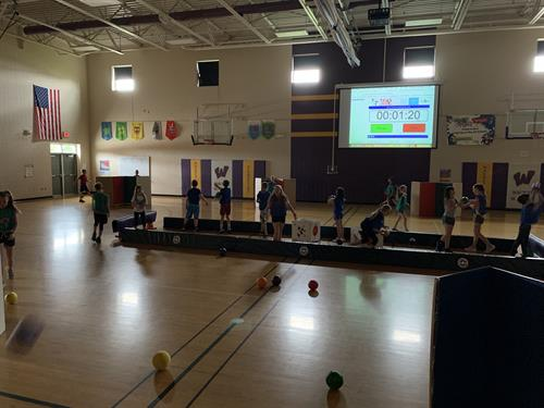 A P.E. class gets moving with kids wearing heart-rate monitors, part of the IHT Spirit System
