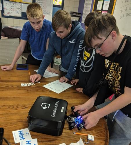 Waukee students learn to problem-solve through a team-building activity with Breakout Boxes