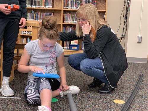 Waukee students learn to program Edison robots through a classroom grant