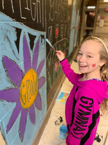 Brookview Elementary students inspired and helped paint a new permanent mural in their school