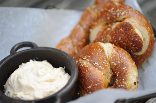 HOUSEMADE SOFT PRETZELS  TOPPED W/ SEA SALT, CARAWAY & SERVED W/ BEER CHEESE SPREAD