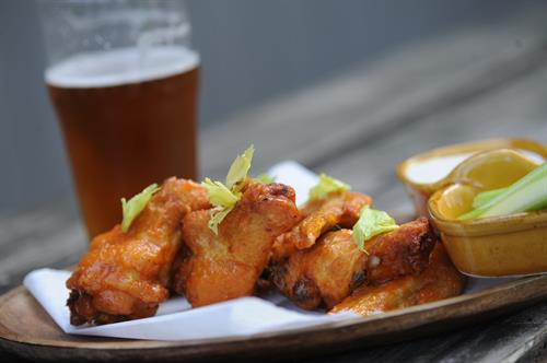 SMOKED & GRILLED CHICKEN WINGS  HONEY ADOBO SAUCE & SERVED W/ CELERY & BLUE CHEESE DRESSING