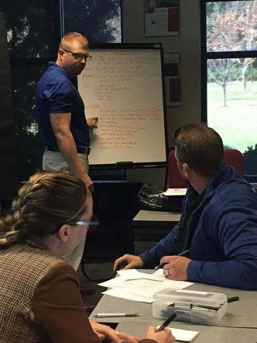Lean Six Sigma Green Belt participants work on capstone project