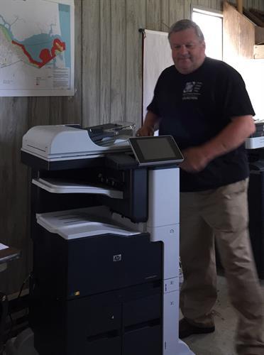Ken installing an HP Color Multifunctional Copier,Print,Scanner, Sort and Auto Staple