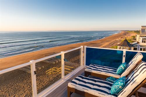 Gallery Image Lark_Suite_deck_lounge_chairs_sunrise.jpg