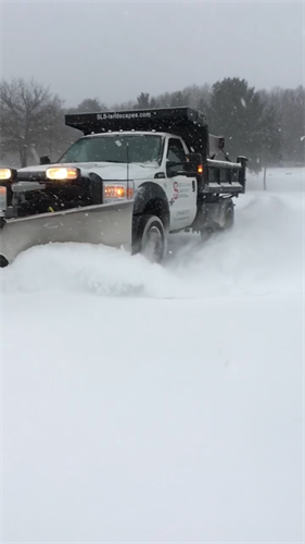 SLS provides COMMERCIAL PROPERTY snow removal
