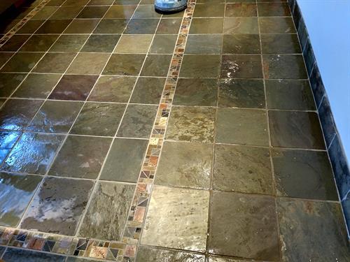 Slate floor being cleaned