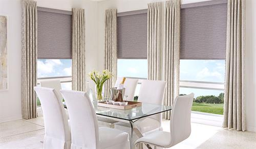 Gallery Image natural-roller-shades-with-drapes-dining-room.jpg