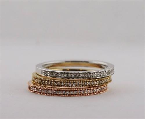 Diamonds look great incorporated into many different colors of gold - check out our Tri-Color Stacking Diamond Rings. Each can be sold separately.