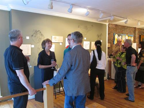 A reception at PEG, usually on Thursday evenings, and featuring one of our great artists, with a Trunk Show of extra work and some fun and relaxing conversation
