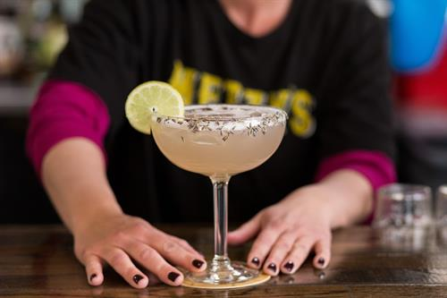 Metzy's Bartender serving a House Specialty Margarita