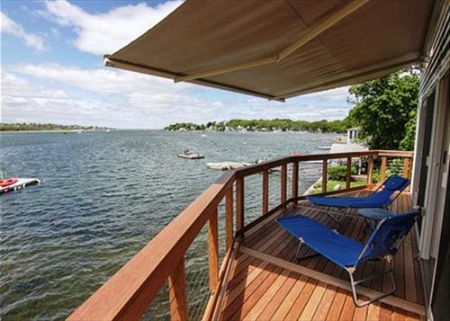 No better place to relax than the deck at River Breezes Cottage