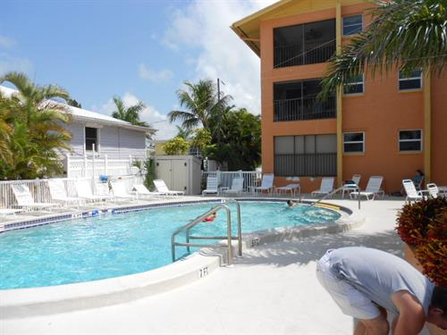 The heated pool is at the gulf end of the complex, just steps from the beach