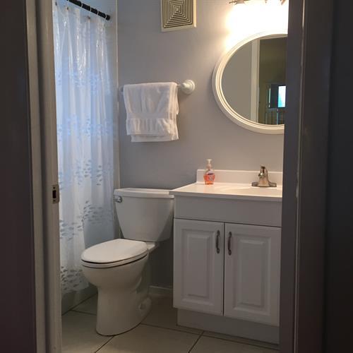 Master bath has new high rise toilet, faucet, light, towel bars & wall storage.