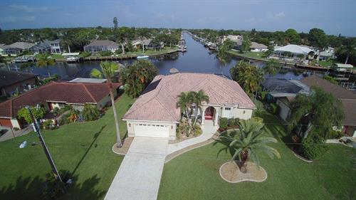 Just Listed - Gulf Access, intersecting canal Pool Home with Boat Dock & Tiki Hut