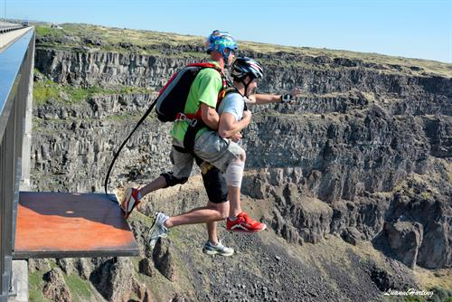 A jumper makes a Tandem BASE jump from the Perrine Bridge