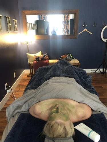 Client soaking in quiet time while a probiotic masque works her skin