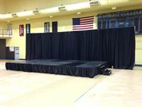 Stage with Black Pipe and Drape Backdrop