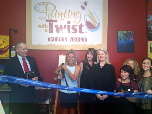 Ribbon Cutting at Paining with a Twist, John Bennett of Loudoun Chamber and Melanie Bailey of Painting with a Twist