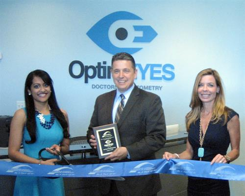 OptimEyes Ribbon Cutting at Broadlands, Tony Howard, President of the Loudoun Chamber with Dr. Seema Mohanan of OptimEyes