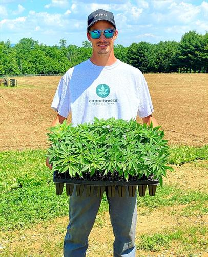 Director of Cultivation displaying our seed starts