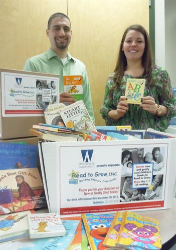 Gregg Lionetti and Kayla Anrico prepare a collection of books for donation to Read to Grow