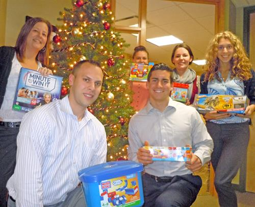 Members of our Pulse Young Professionals get ready to celebrate the Holiday with donations for the GNHCC Annual Toys for Tots drive.