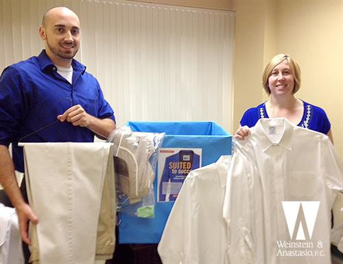 Phil Peiper and Lisa Extance prepare clothing donations for the United Way of Greater New Haven's Suited for Success clothing drive.
