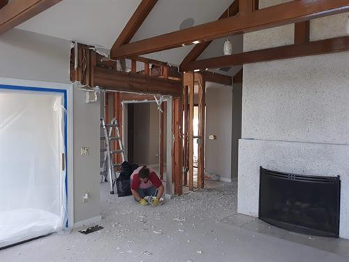Removing existing fireplace and wall to have open concept