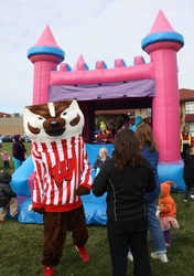 Bucky Badger enjoying the bounce house at Oak Bank's Fall Fundraiser.