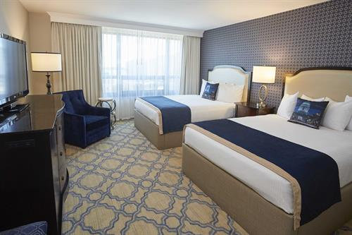 "Guest rooms include microwaves, refrigerators, and 42"" inch HDTVs."