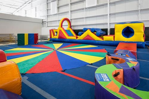 A typical birthday party set up includes bounce houses, obstacle courses, and more fun activities.