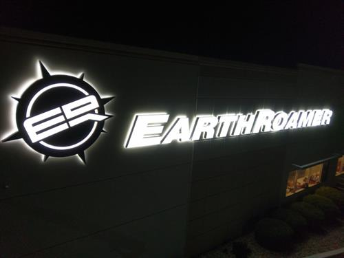 EarthRoamer backlit and front lit logo and letters at night