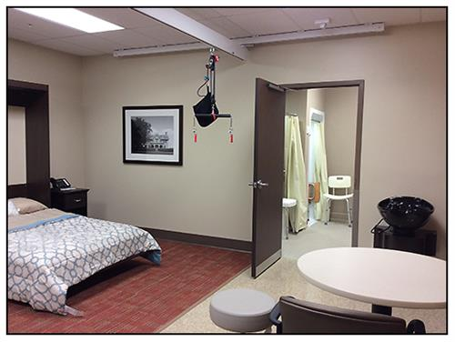 Our Activities of Daily Living Suite is located in our gym.  It includes a full kitchen, washer and dryer, a walk in and tub shower, and bed.  We use this area to help prepare our patients for daily home tasks.
