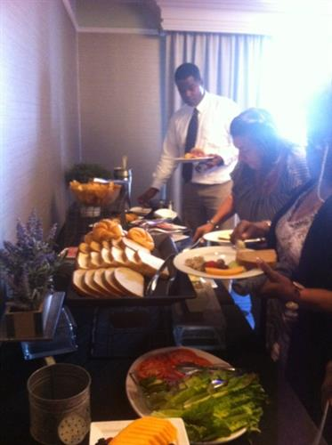 """Attendees enjoying our buffet lunch at the """"Cultivating Ownership"""" networking class event."""