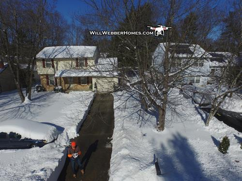 Drone view --- Neighbor's CLEAN driveway after the snow.