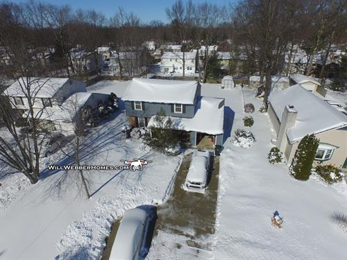 Drone view --- Neighbor's CLEAN driveway after the snow