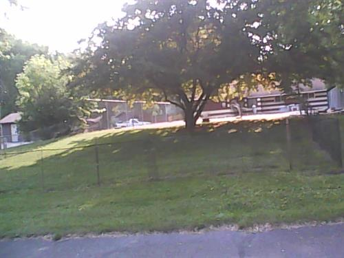 A  small fenced in dog park for small dogs.  Pick up your dog poo here and in campgrounds.