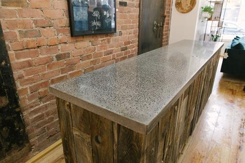 Pewter reception desk at Tuck Studio, Saint John