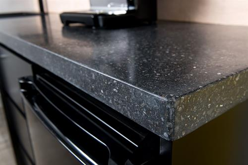 Black concrete countertop for an office kitchenette in Fredericton.