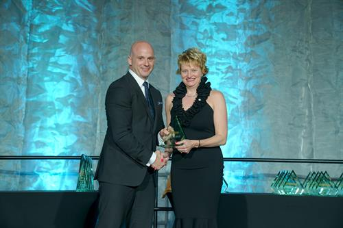 DMC CEO Dallas Mercer accepting the TOP 50 CEO Award in 2019