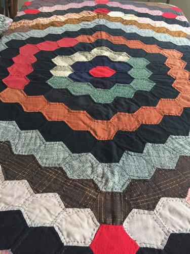 "A ""Hexi"" wool quilt made in Amish-like fashioned."