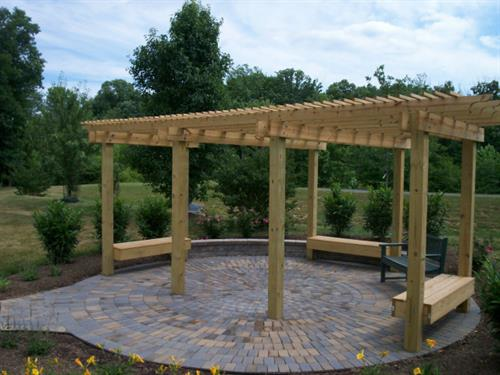 Timber pergola and paver patio installation performed by Terra Landscape and Design