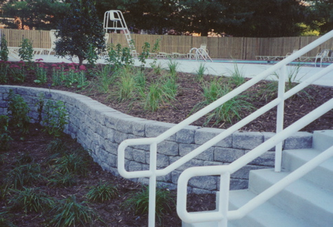 Curved retaining wall and plant installation by Terra Landscape and Design