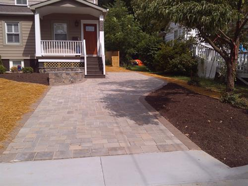 Paver driveway to reduce water runoff, last longer than concrete and improve curb appeal, by Terra Landscape and Design