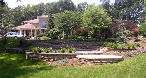 Tiered patios, retaining walls and plant installations performed by Terra Landscape and Design