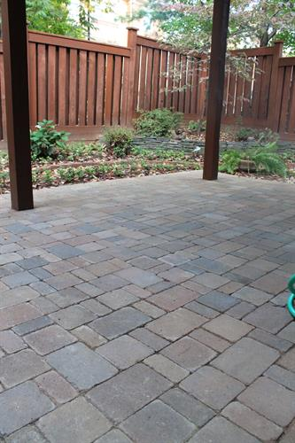 Townhouse patio and dry creek bed to reduce water runoff and erosion, design and installation by Terra Landscape and Design