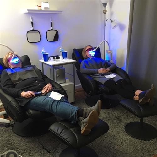 Clients in our massage, heated chairs